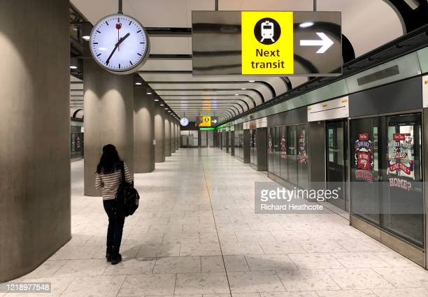 Passenger waits for the transit train in Terminal 5 at Heathrow Airport on April 15, 2020 in London, United Kingdom. The airport expects 90% fewer...