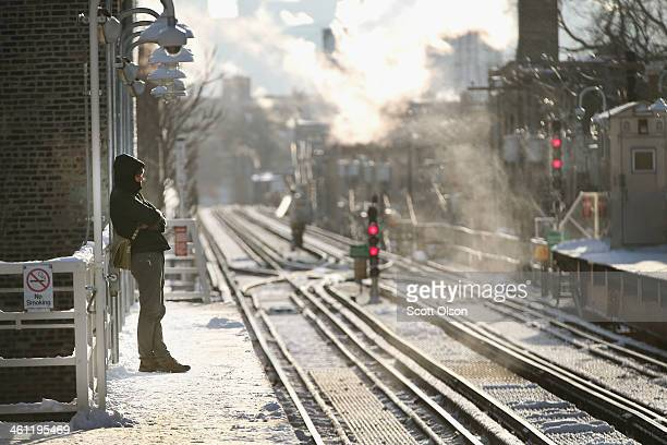 A passenger waits on an L platform for the train to arrive in below zero temperatures on January 7 2014 in Chicago Illinois Many trains were delayed...