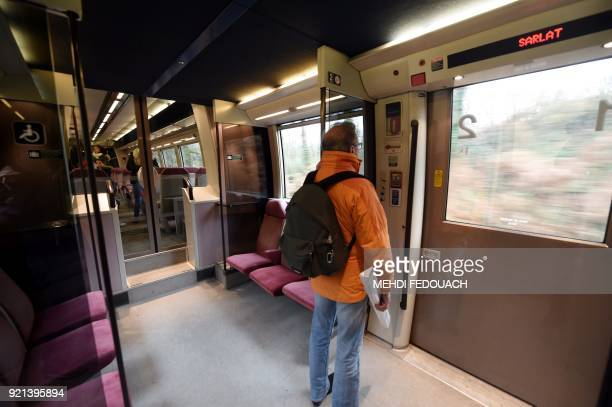 A passenger waits to alight the train as arrives at the train station in Sarlat on February 20 as the line which serves the station is under the...