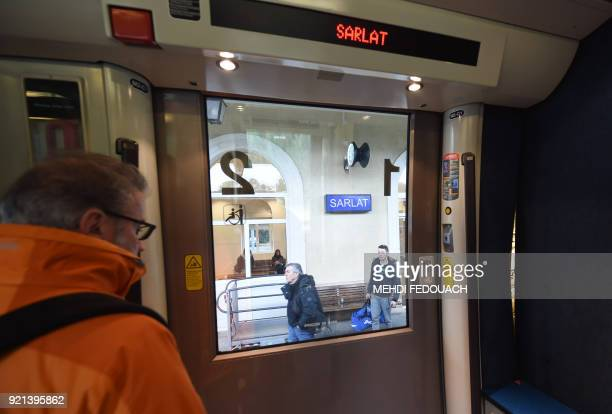A passenger waits to alight the train as others wait to board at the train station in Sarlat on February 20 as the line which serves the station is...