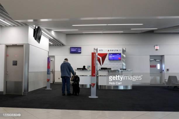 A passenger waits to board a Baltimore Maryland bound Delta flight from HartsfieldJackson Atlanta International Airport on April 20 2020 in Atlanta...