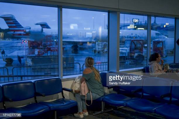 A passenger waits to board an American Airlines flight to Roanoke Virginia at Charlotte International Airport on May 20 2020 in Charlotte North...