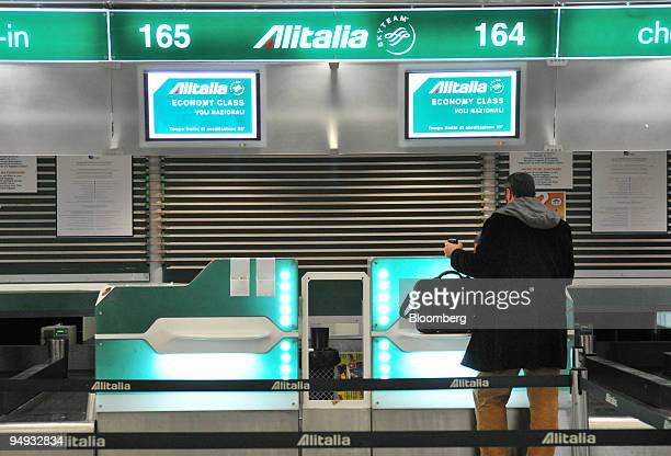A passenger waits to checkin at the Alitalia desks at Rome's Fiumicino airport in Rome Italy on Tuesday Dec 9 2008 Air One owner Carlo Toto will...