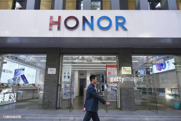 Passenger walk past a Huawei Honor store on November 10, 2020 in Hangzhou, Zhejiang Province of China.