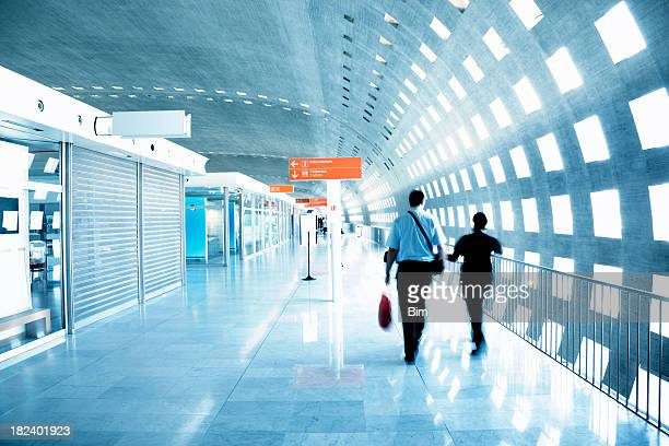 Passenger Walking Through an Airport Corridor, Blurred Motion
