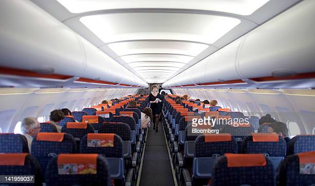 A passenger walks along the aisle of an Easyjet aircraft ahead of a flight to Barcelona from London Southend Airport part of the Stobart Group Ltd in...