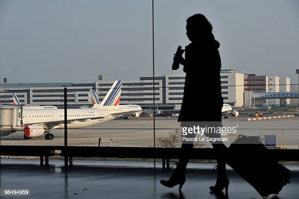 A passenger walks in a terminal at the CharlesdeGaulle airport in Roissy on April 16 2010 in Paris France Roissy CharlesdeGaulle airport has been...