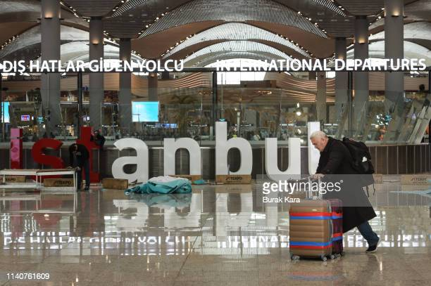 A passenger walks in the departures terminal of new Istanbul Airport on April 06 2019 in Istanbul Turkey Ataturk Airport was opened in 1953 and was...