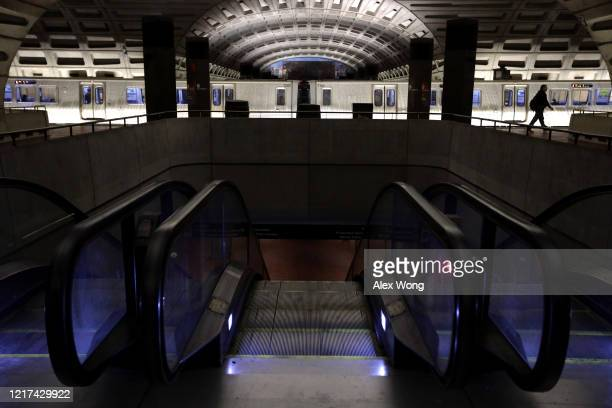 A passenger walks on the platform at an empty Metro Center Station April 7 2020 in Washington DC Washington Metropolitan Area Transit Authority...
