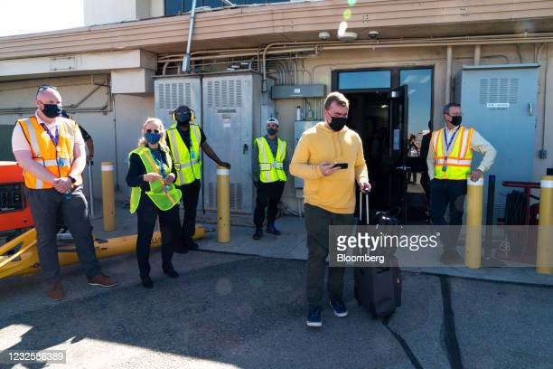 Passenger walks onto the tarmac ahead of the Avelo Airlines inaugural flight at Hollywood Burbank Airport in Burbank, California, U.S., on Wednesday,...