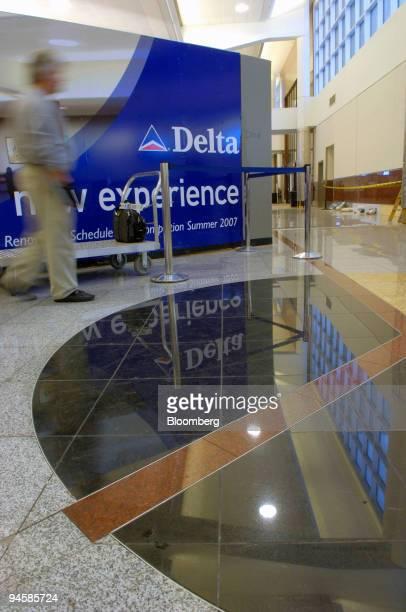 Passenger walks past a Delta promotional billboard inside Atlanta's Hartsfield Jackson International Airport on Wednesday November 15 2006 US Airways...