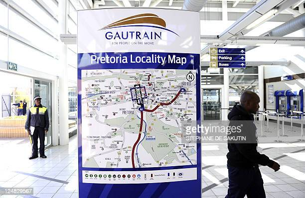 A passenger walks past a route map on August 2 2011 at the Pretoria station for Gautrain Africa's first highspeed rail line South Africa's first...