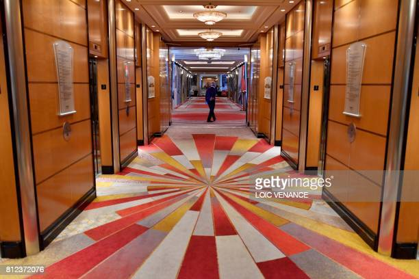 A passenger walks through a corridor aboard the Cunard cruise liner RMS Queen Mary 2 sailing in the Atlantic ocean during the Bridge 2017 a...
