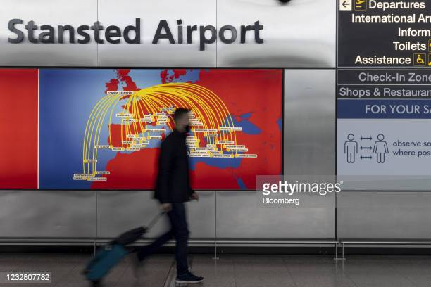 Passenger walks through London Stansted Airport, operated by Manchester Airport Plc,in Stansted, U.K., on Monday, May 10, 2021. The U.K. Governments...
