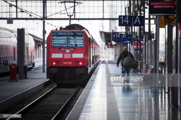 A passenger walks to a regional train after a strike by Deutsche Bahn workers at central station on December 10 2018 in Frankfurt/Main Germany The...