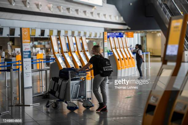 Passenger walks to Lufthansa check in counter at Frankfurt Airport during the novel coronavirus pandemic on June 15, 2020 in Frankfurt am Main,...