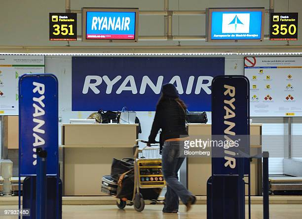 A passenger walks towards a Ryanair checkin desk at Barajas airport in Madrid Spain on Friday March 19 2010 Ryanair Holdings Plc Europe's largest...