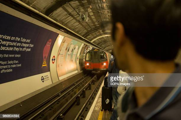 A passenger watches an incoming subway in London London is the Capital city of England and the United Kingdom it is located in the south east of the...