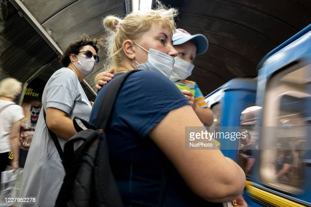 Passenger wear protective face mask inside a subway amid the outbreak of the coronavirus disease COVID-19 in Kyiv, Ukraine on August 07, 2020