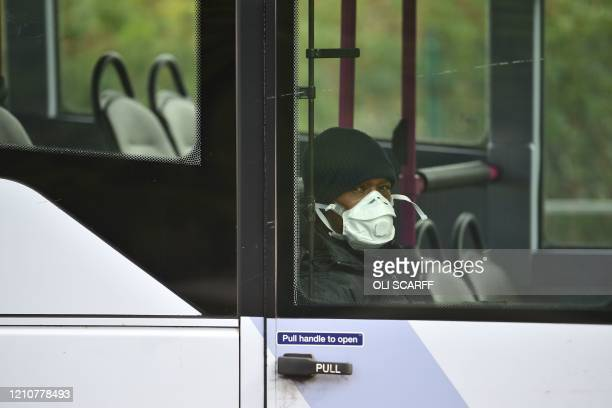 Passenger wearing a face mask as a precaution is seen on a bus in Leeds, northern England, on April 23, 2020 as life continues under lockdown in...
