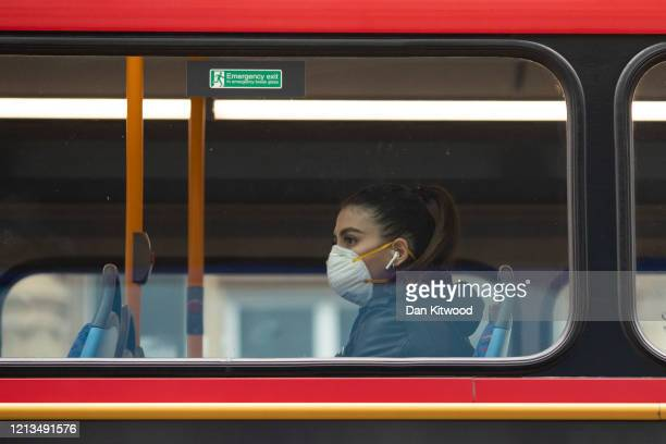 Passenger wearing a face mask rides a bus on Oxford Street on March 19, 2020 in London, England. Transport for London announced the closure of up to...