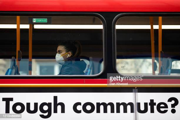 A passenger wearing a face mask rides bus on Oxford Street on March 19 2020 in London England Transport for London announced the closure of up to 40...
