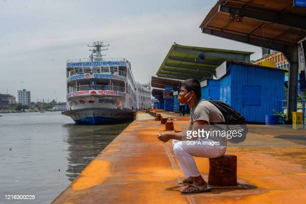 Passenger wearing a facemask, waits at the boat terminal. Bangladesh government is likely to end the ongoing nationwide lockdown to contain Covid-19,...
