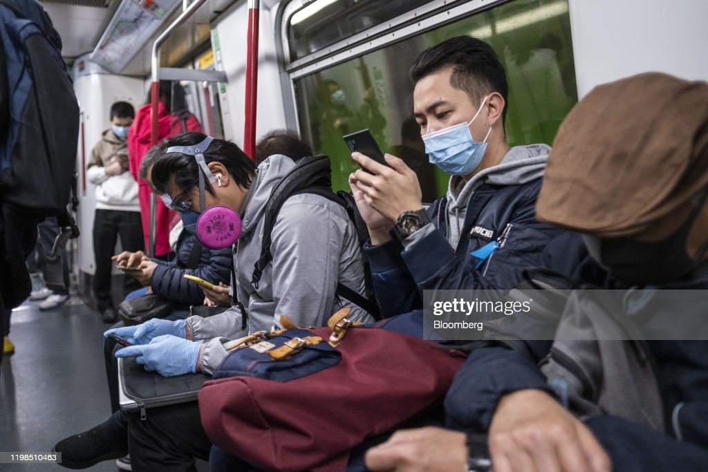 Reactions as Hong Kong Confirms First Virus Death : News Photo