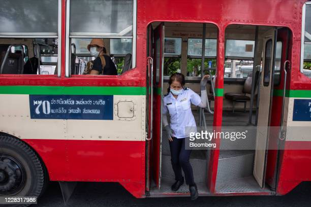 A passenger wearing a protective mask disembarks a bus in Bangkok Thailand on Wednesday Sept 2 2020 Thailand has reported zero locallytransmitted...