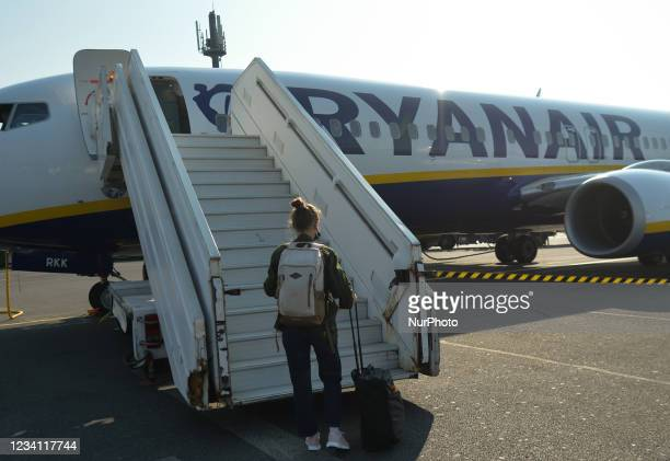 Passenger wearing face masks boards the Ryanair plane at Paris-Beauvais airport. On Thursday, July 22 in BeauvaisTillé Airport, Oise,...