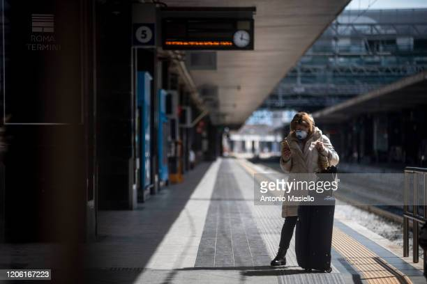 Passenger wearing face masks waits at the Termini Central Station during the Coronavirus emergency, on March 9, 2020 in Rome, Italy. Italian Prime...