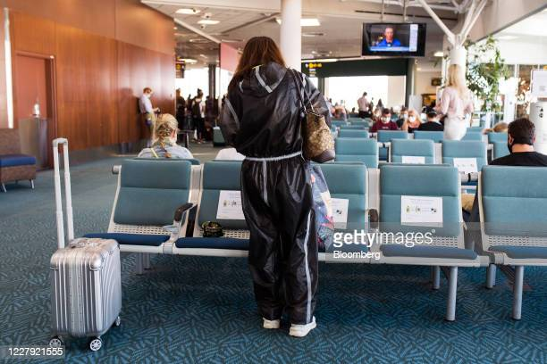 Passenger wearing personal protective equipment waits for a flight at Vancouver International Airport in Vancouver, British Columbia, Canada, on...