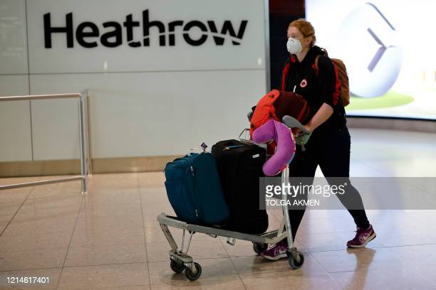 A passenger wearing PPE arrives at Terminal 2 of Heathrow airport west London on May 22 2020