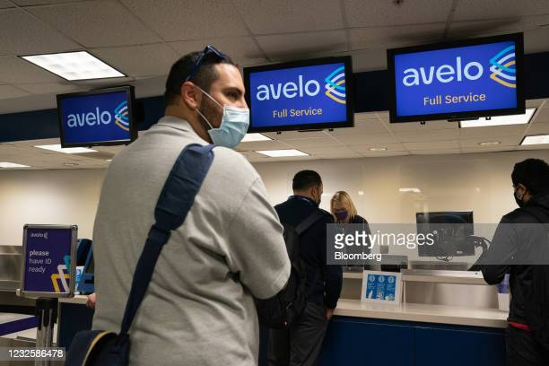 Passenger wearing protective masks check-in ahead of the Avelo Airlines inaugural flight at Hollywood Burbank Airport in Burbank, California, U.S.,...