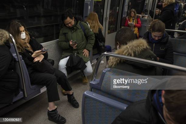 A passenger wears a face mask while riding a underground Metro train during morning rush hour in Paris France on Monday March 2 2020 Group of Seven...