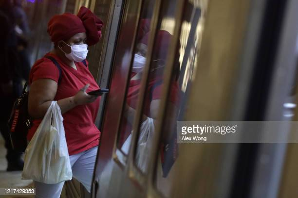 A passenger wears a mask as she enters a Metro train car at Metro Center Station April 7 2020 in Washington DC Washington Metropolitan Area Transit...