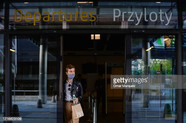 Passenger wears a protective face mask as he arrives from Warsaw at the terminal of John Paul II Krakow International Airport on June 1, 2020 in...