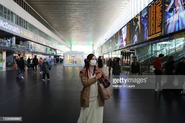 Passenger wears a protective mask while waiting at Termini Central Station on March 8, 2020 in Rome, Italy. Prime Minister Giuseppe Conte announced...