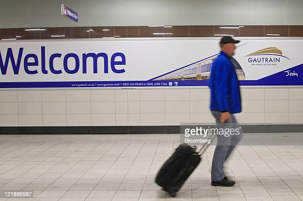 A passenger wheels his luggage through Gautrain's Rosebank mass transit rail station in Johannesburg South Africa on Monday Aug 22 2011 South Africa...
