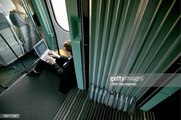 Passenger with a Laptop sitting on the bottom of a crammed full ICE