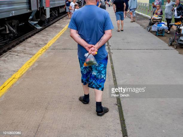 A passenger with fruit and veg purchased from station vendors during a stop on the TransSiberian Railway from MoscowVladivostok Spanning a length of...