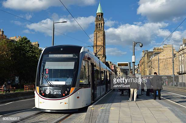 Passengers and an Edinburgh tram at one of the stops