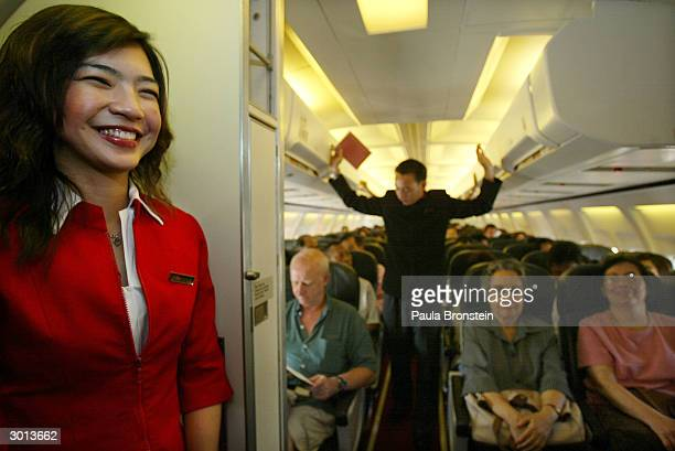 Passengers and crew get ready to take off on the Air Asia Boeing 737300 flight from Bangkok to Phuket on February 25 2004 in Bangkok Thailand The...