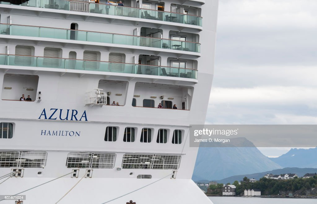 Passengers and crew on board P&O Cruises ship, Azura, as she prepares to depart port on her seven day cruise from Southampton on August 15, 2017 in Alesund, Norway. With over 3000 guests and 1200 crew, the 115,000 tonne ship is on a seven day Norweigian fjord cruise from Southamton arriving back on the 19th August 2017. Summer is a popular time for the Norweigan Fjord cruise industry with dozens of cruise ships in the waters off Norway with tens of thousands of visitors disembarking every day.