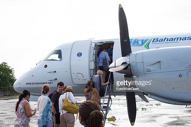 Passengers and tourists are boarding at an aircraft of the domestic and regional airline Sky Bahamas at Lynden Pindling International Airport or so...