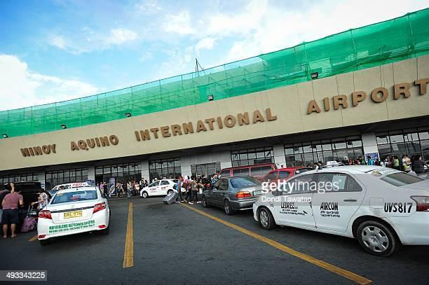 Passengers and well wishers wait for their flights at the dilapidated international airport which has been named one of the world's worst airports on...