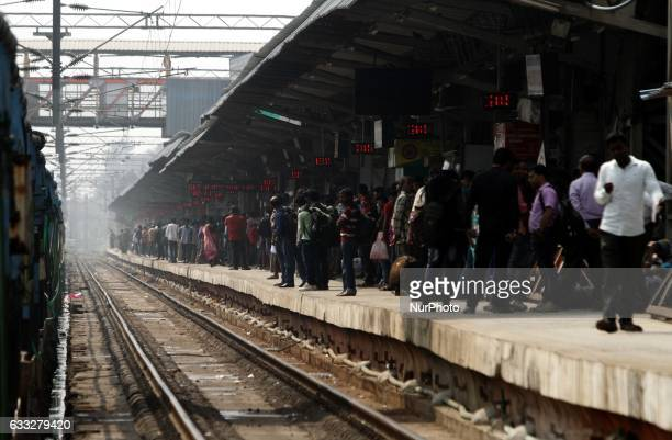 Passengers and workers look in the city railway station as they are busy in their concern in the eastern Indian city Bhubaneswar India Wednesday 01...