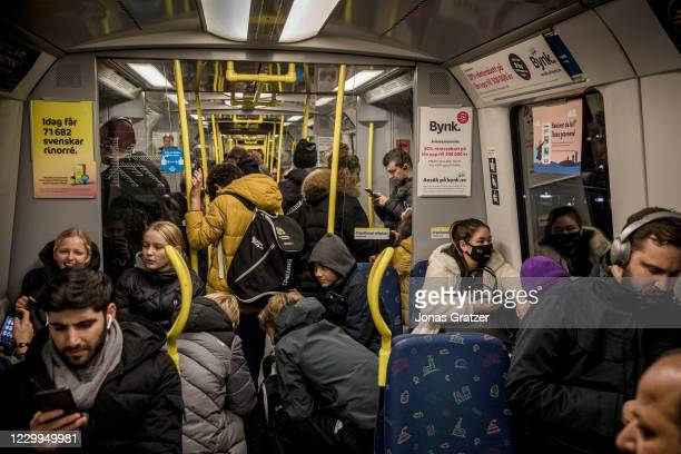 Passengers are crammed into a packed subway car in the middle of the ongoing Covid-19 pandemic, on December 4, 2020 in Stockholm, Sweden. Over 7,000...