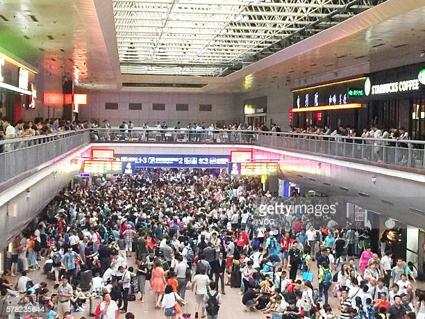 Passengers are detained at Beijing West Railway Station as many railway line are delayed due to heavy rainstorm on July 21 2016 in Beijing China...