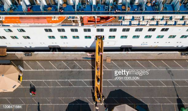 Passengers are disembarked from the Grand Princess cruise ship at the Port of Oakland in Oakland California on March 10 2020 The first passengers...